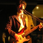 The Australian Beatles Show. Ron plays the part of John Lennon in the 3Bs Beatles cover band